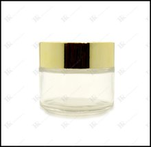100ml empty glass jars for cosmetics with gold/silver lid on stock
