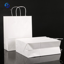 China Fashion style shopping high quality craft kraft custom paper bag