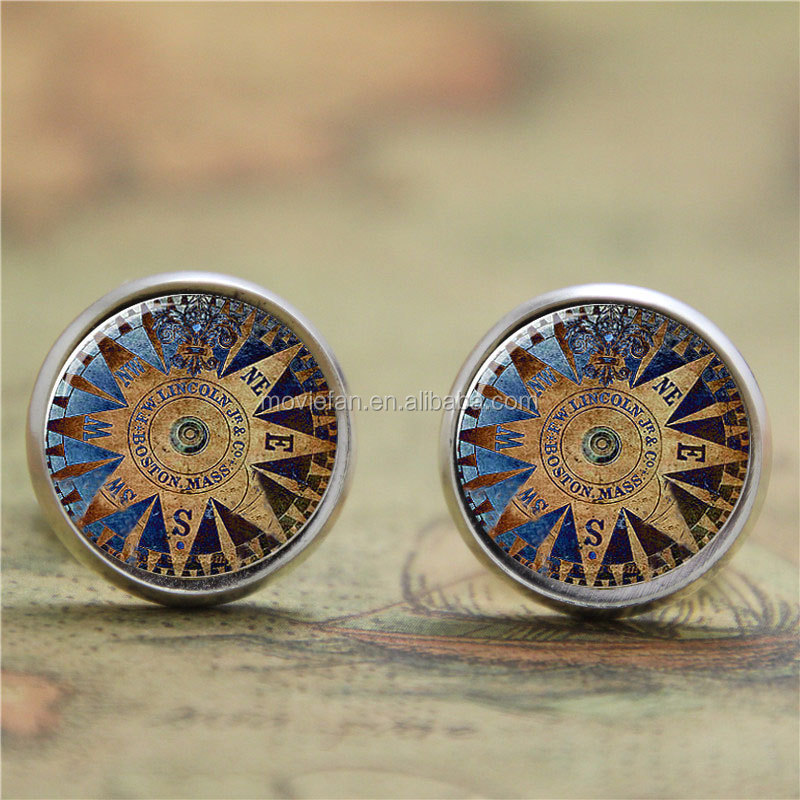 Compass earring dial and magnetic needle that always points to the north earring glass Photo Nautical earring