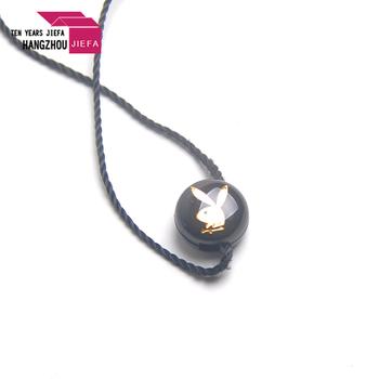 wholesale eco-friendly black animal logo plastic seal tag for garment