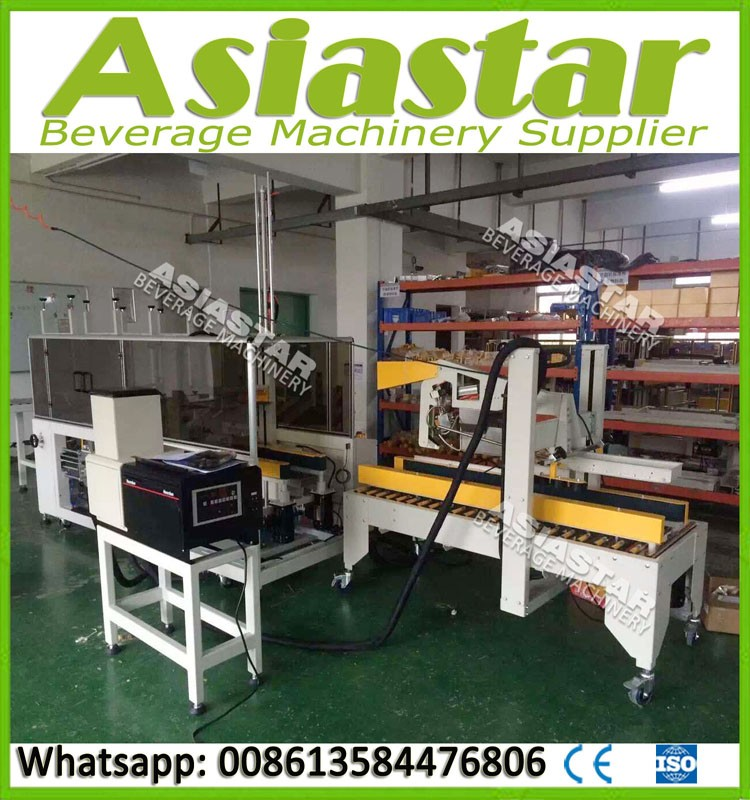 Fully automatic heat shrink film packing machine