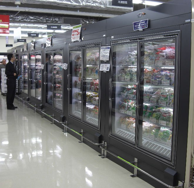Freezing Showcase for Supermarket with Oscillating Harmonic System
