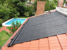 Rubber solar collector for swimming pool