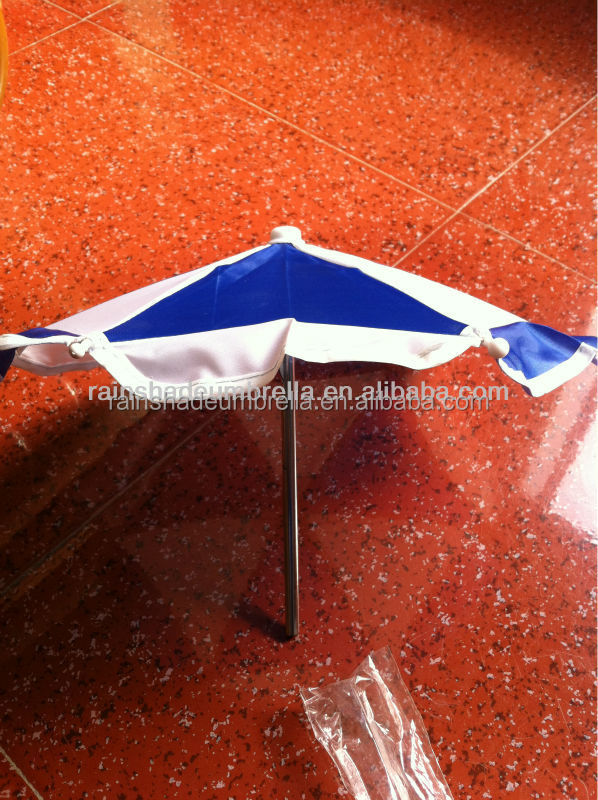 very small toy umbrella or put on the bear umbrella
