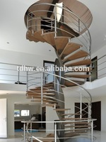 interior columbus circle curved stair with wood tread and stainless steel rod fence