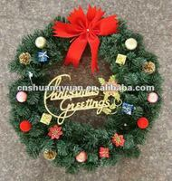 Artificial christmas wreath with ornament