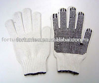 Knitted gloves with PVC dots