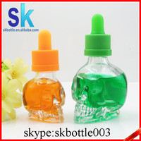 Wholesale 2015 clear skull shape glass 15ml 30ml dropper eliquid bottle with childproof cap and needle tip