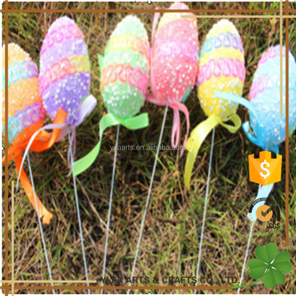plastic decorated Easter eggs on sticks