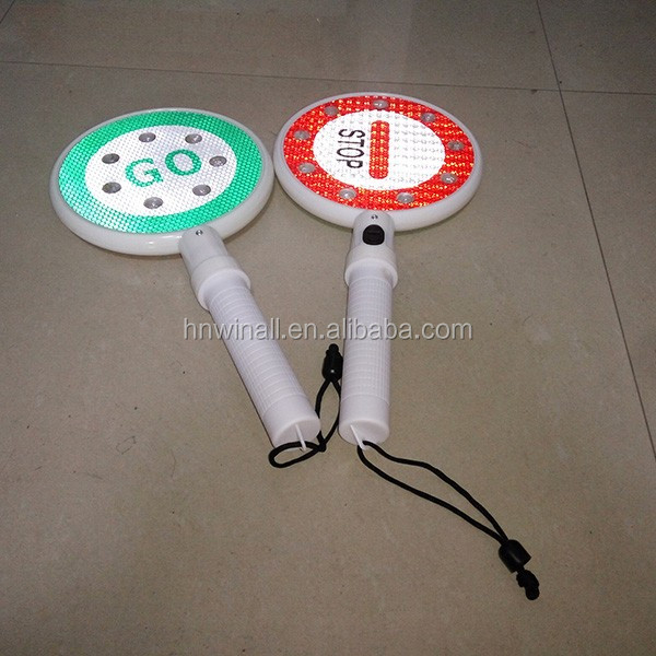 reflective handheld police stop and go sign light.jpg