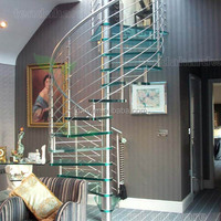 Bespoke glass tread stainless steel fence spiral staircase