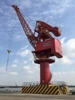 fixed portal gantry crane rack luffing single jib 360degree rotation loading and unloading containers and bulk cargo in the port