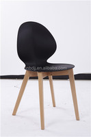 high quality seashell shaped back and seat wood legs plastic chair for dining cafe furniture
