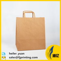 Natural brown kraft paper shopping bag with flat tape handle