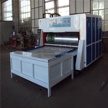 Multi-color printing and slotting machine/carton package machine