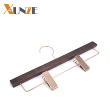 Luxury brand wood pants hanger with rose gold copper clips