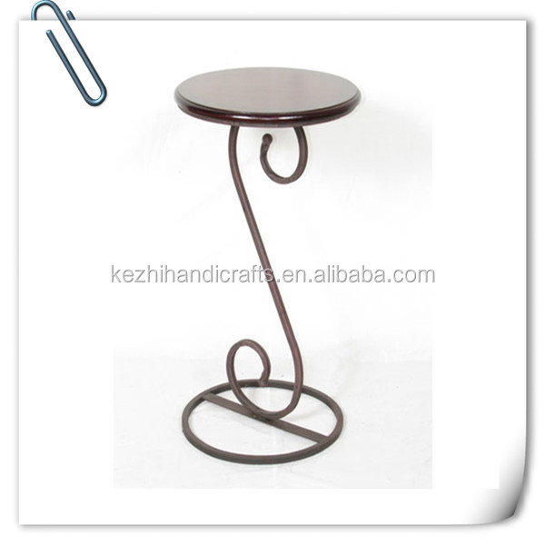 antique wrought iron and wooden indoor plant stand