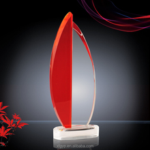 Red and clear crystal trophy with oval base
