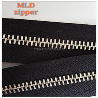 Open ended metal zippers