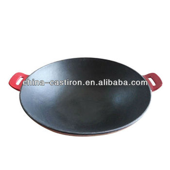 enamel or preseasoned cast iron wok