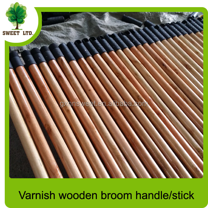 varnished wooden broom stick with cap