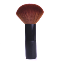 Powder brush with black handle and brown hair