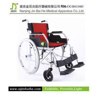 Manual wheelchair type folding wheelchair with flip up armrest
