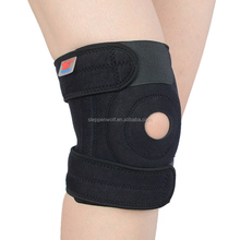 Compression neoprene knee support with adjustable spring neoprene and compression silicon pad