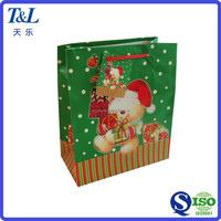 Factory direct supply good looking and low price Christmas paper gift bag with top quality
