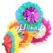 unusual fringed and layered Hawaiian party cocktail parasols in a mix of bright colours. for wedding table decoration