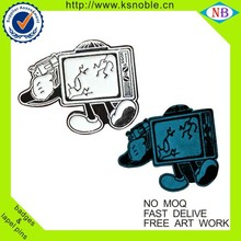 Promotional TV design lapel pin with glow in the dark custom metal glow badge