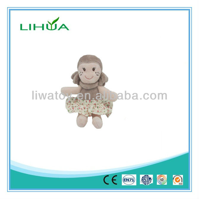 Soft baby doll toy in dress