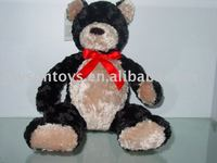 animal shaped stuffed bear shaped toy with a bow