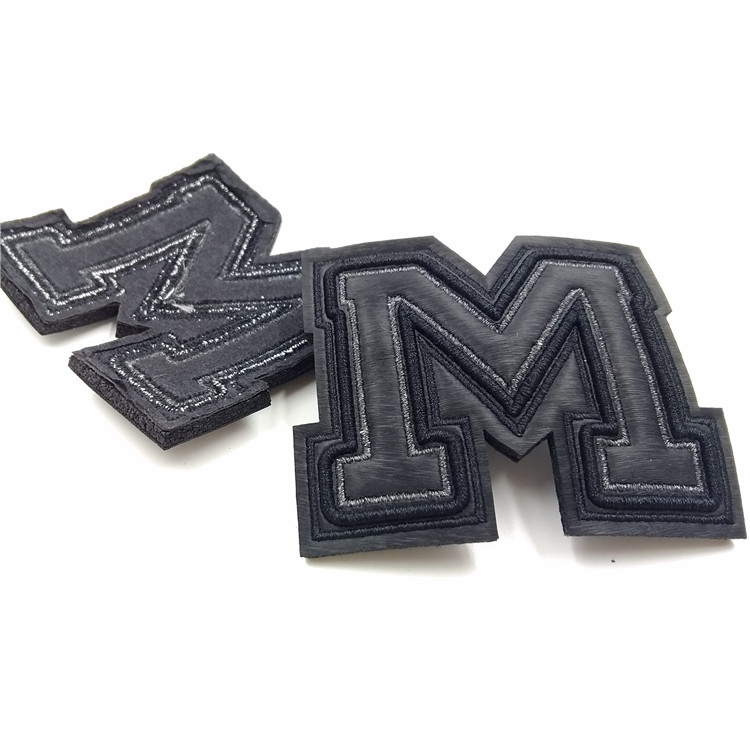 wholesale emboridery black self adhesive laser cut leather logo patch