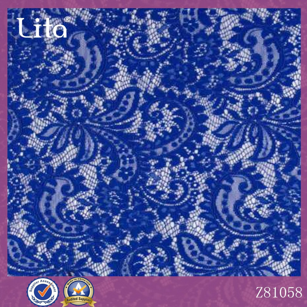 Sparkly swirly stretch lace fabric blue