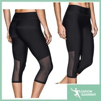 Woman black blank design transparent elastic mesh sports pants