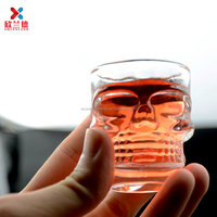 Halloween special mini glass skull cups of whisky