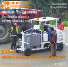 Automatic thermoplastic road striping machine