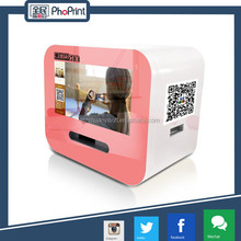 Pink mini photo printer ad device for photo booth kiosk