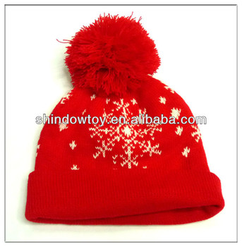 knitted hat with top ball all red with white snowflake pattterns