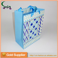 Customized logo printed colorful specialty paper gift bag with ribbon handle