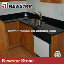 Prefab flat black countertops with wooden cabinets