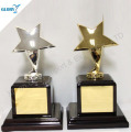 star shape metal trophy with wooden base award