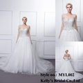 A hot sales crystal beaded on top shimmer tulle for skirt with long sleeve see through back sweetheard wedding dress MYL002