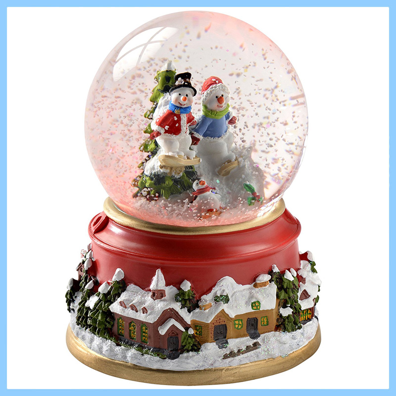 Penguin and Skiing Snowmen Snow Globe