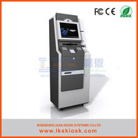 standing at the bank atm parts kiosk with touch screen