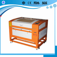 Co2 hand laser label die cutting and engraving machine with 260W for metal and non metal cutting for sale