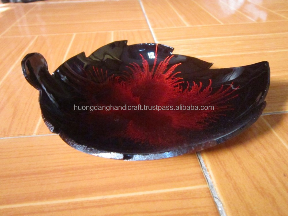 Wonderful coconut shell bowl in heart shape with natural color outside and shiny firework pattern inside