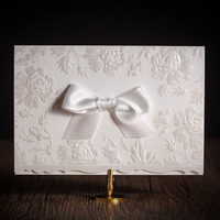 white flower embossed wedding invitation card with ribbon CW5199