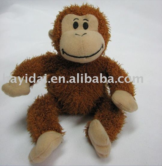 Brown plush and stuffed monkey toy